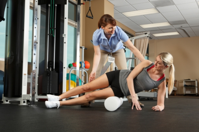 Woman Physical Therapist Instructor Helping Her Patient